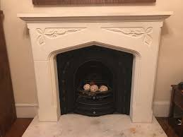 cream fire surround with marble hearth