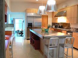 view in gallery wooden cabinetry and stainless steel countertops in a modern kitchen