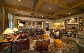 cigar room man cave with home bar and leather furniture