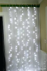 diy photobooth backdrop hanging tulle and string lights photo booth ideas for your next shindig streamers diy photobooth backdrop