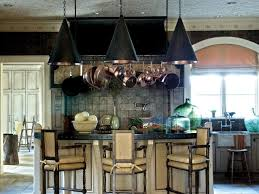 kitchen hanging pots and pans on wall laminate teak wood flooring lofty vaulted ceiling long