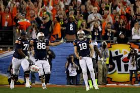 kicker wes byrum 18 of the auburn tigers reacts after he kicks a 19 yard game winning field goal to defeat the oregon ducks 22 19 in the tosos bcs