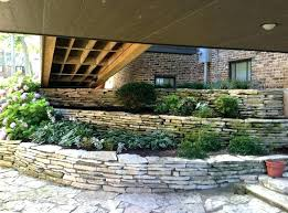 build a retaining wall on a slope building a stone retaining wall 1 4 u 1