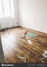 hardwood plank parquet installation room modern white walls stock photo