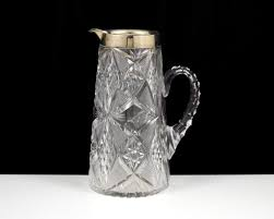 an antique george v sterling silver mounted water jug by john grin sons birmingham
