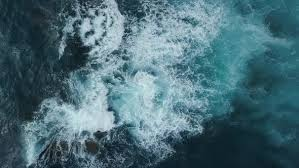 Aerial View Of Sea Waves Blue Ocean Background Flying Above Water
