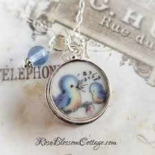 singing blue bird and baby bird broken china jewelry charm pendant necklace