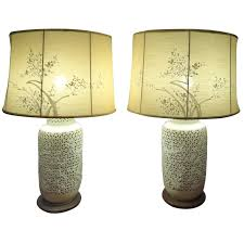 pair of blanc de chine lamps with silk shades for