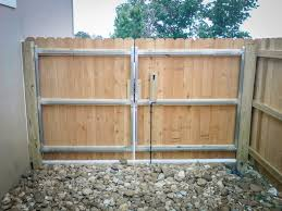 image of wood fence gate hardware hinges and latch
