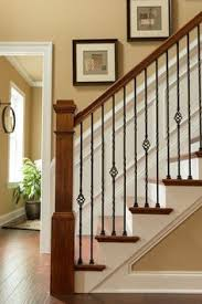 craftsman staircase with high ceiling wainscotting chair rail hardwood floors chairrail