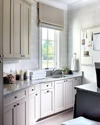 grey granite countertops beautiful gray laundry room features light gray shaker cabinets finished with satin nickel