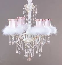 white chandelier with six lamps combined with white fluffy ornaments also many hanging glass crystal ornaments