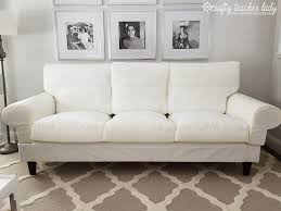 white costco leather sofa on gray rugs