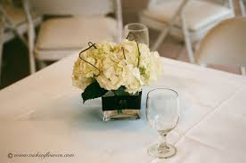 wedding centerpieces 023 classy white hydrangea centerpiece in a square glass vase wrapped in black ribbon