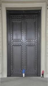 the bronze doors of the national archives building in washington d c each is 37 ft 7 in 11 5 m tall and weighs roughly 6 5 short tons 5 9 t