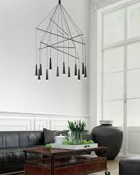 designer filippo mambretti of mambrò design studio has created mikado a pendant chandelier for italian lighting brand morosini