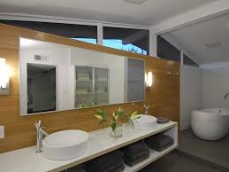 a mid century bath in a ranch style house gets an update with modern vanities and easy to reach storage