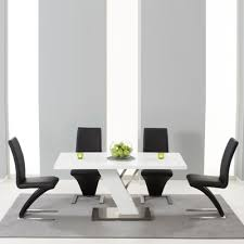 to high gloss white dining table with 6 harvey black chairs 5467