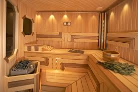 new sauna with l shape using two tones of wood for a more intricate interior
