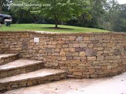 front entrance dry stack stone wall and