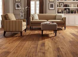 Excellent Shaw Laminate Flooring Matched With Ivory Wall Plus Beige Sofa  And Ottoman For Living Room