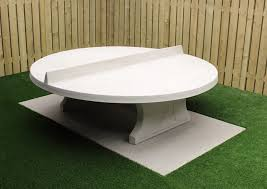 round ping pong table in natural concrete