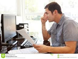 working for home office. Hispanic Man Working In Home Office. Concentrating, Documents. For Office