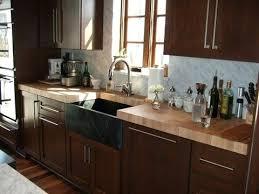 luxury butcher block countertop black cabinets