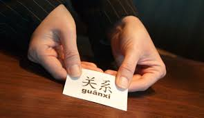 how to do business in guanxi the chinese art of networking guanxi exchanging business cards