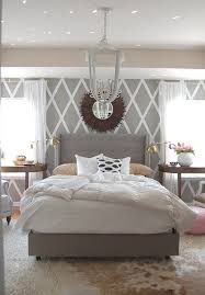 grey white bedroom with cowhide rug