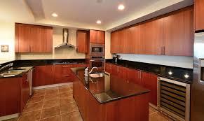 modern kitchen with cherry cabinets dark granite counter