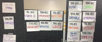 school bathroom mirror. photo: one california high school posted bathroom doors with signs of affirmation. mirror