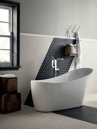 geometric hexagonal tiles create a monochrome arrow across this fired earth bathroom
