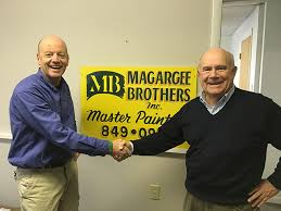 len magargee right shakes hands with his business partner kevin nolan one