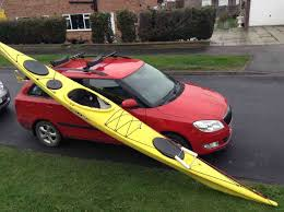 the red going from the end of the kayak to the roof bar is to stop it sliding off accidentally