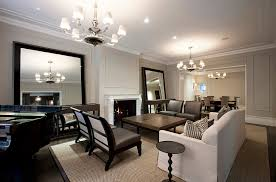 large mirrors combine with the simple color palette to usher in some hollywood regency charm