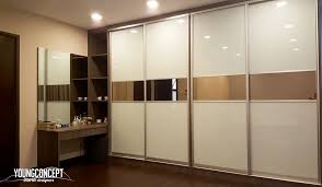 built in wardrobe with integrated vanity and open shelving by young concept