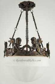 cast brass cherub chandelier with inverted glass dome circa 1920s