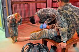 u s department of defense photo essay u s army pfc jenna serena left observes as spc paul evans treats