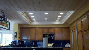 wooden ceiling with square led lighting above the kitchen island bright lights white and golden chandelier surface mount brightest light fixtures flush