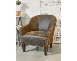 with its comfortable tub chair profile distressed leather cover and nailhead trim