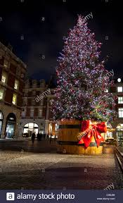 Giant Christmas tree decoration in Covent Garden at night, London, England,  UK, 2011