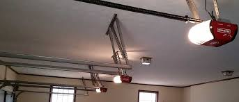 garage door opener installation by precise assemblies triple garage with single light gdos