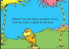 this book is called the lorax written by dr seuss these pages are an exle of a full page spread because it uses 2 pages the trees are also bleeding