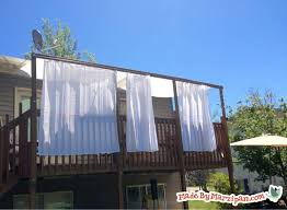 diy deck awning i hung curtain rods on the outside