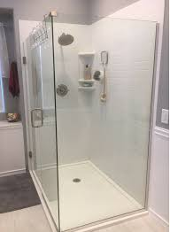 an easy to clean low curb solid surface shower floor pan in white with solid surface