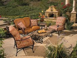 black wrought iron patio furniture with fireplace in the wall and bronze cushion patio chairs black wrought iron table