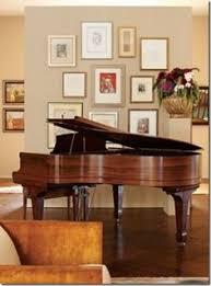 gallery wall behind baby grand piano diamondb  on baby grand piano wall art with tv mogul darren star s art filled bel air home yamaha grand piano