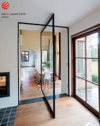 glass pivot interior door with a black frame and clear glass