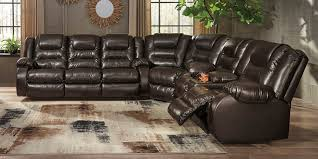 ashley furniture 79307 88 77 94 3 pc vacherie chocolate faux leather sectional sofa with recliner ends
